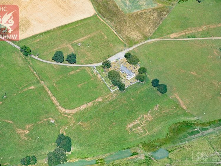 Parchmarks of Roman buildings showing at Caerhun Roman fort in the Conwy Valley. Pic: RCAHMW