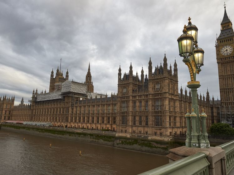 May's majority narrows as DUP MP suspended