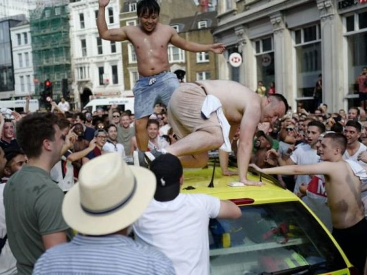 Two half-naked men were dancing on the roof