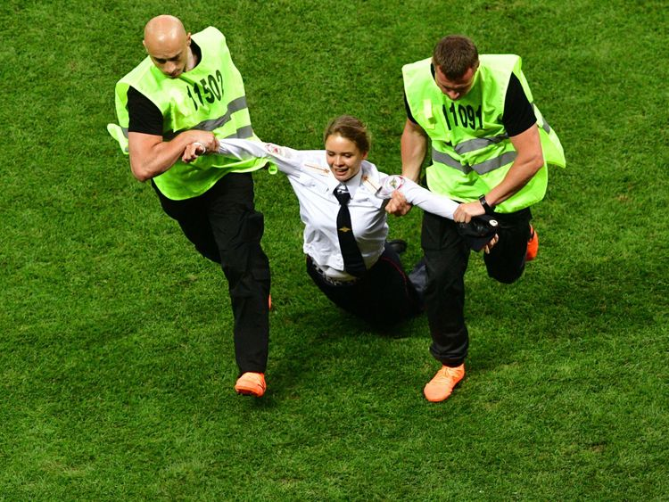 Stewards remove a pitch invader during the Russia 2018 World Cup final football match between France and Croatia at the Luzhniki Stadium in Moscow on July 15, 2018. (Photo by Mladen ANTONOV / AFP) / RESTRICTED TO EDITORIAL USE - NO MOBILE PUSH ALERTS/DOWNLOADS (Photo credit should read MLADEN ANTONOV/AFP/Getty Images)