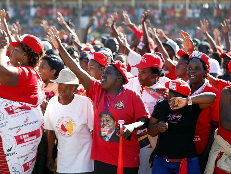 Zimbabwe soldiers clash with opposition supporters as ruling party wins majority