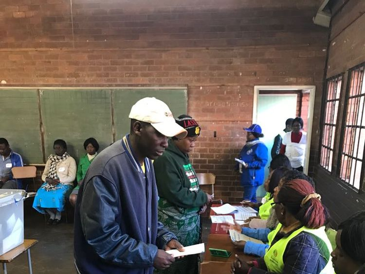 Voters cast their ballots in Kuwadzana, near Harare