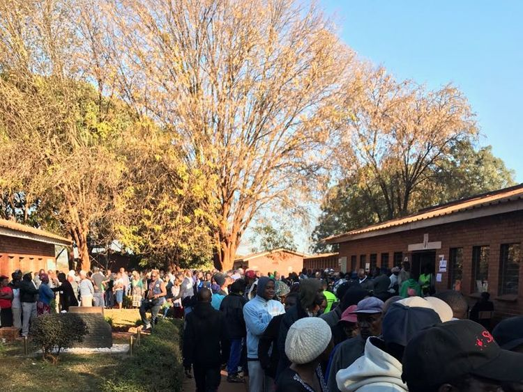 Voters queue to cast their ballots in Kuwadzana, near Harare