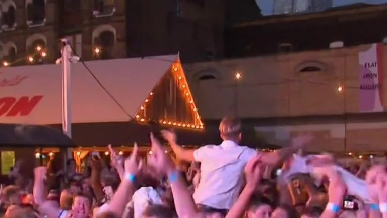 England fans in London celebrate penalties win over Colombia