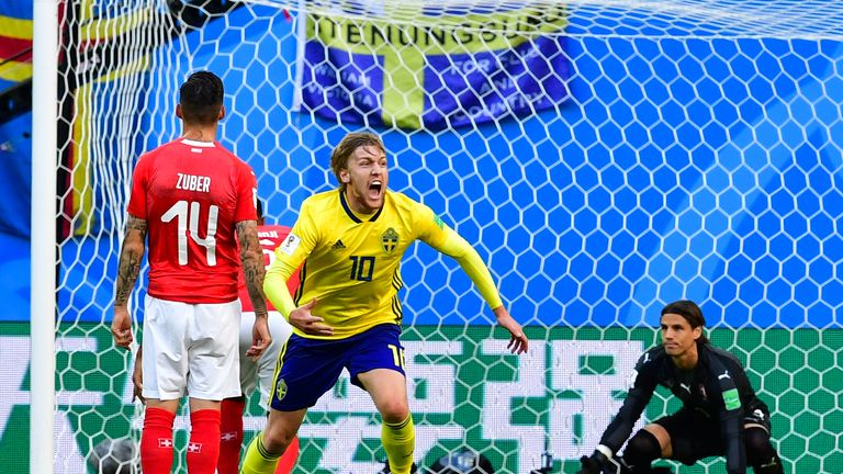Emil Forsberg celebrates after his deflected strike opens the scoring for Sweden