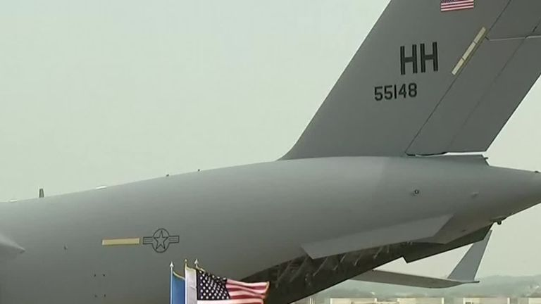 The remains of US servicemen killed in the Korean War are carried off a plane in South Korea