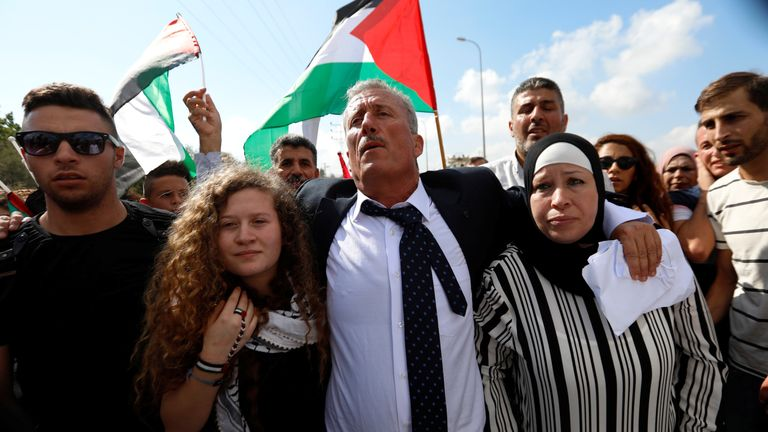 Palestinian teenager Ahed Tamimi and her mother Nareman walk out after they were released from an Israeli prison