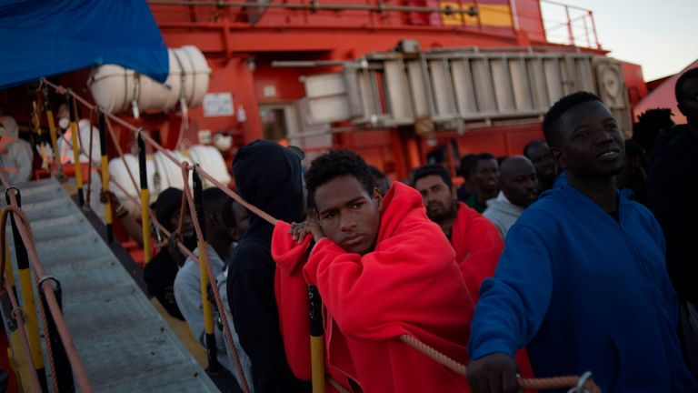 Migrants rescued at sea wait to be transferred at the harbour of Algeciras on July 28, 2018