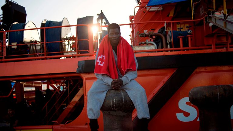 A man rescued at sea waits to be transferred at the harbour of Algeciras