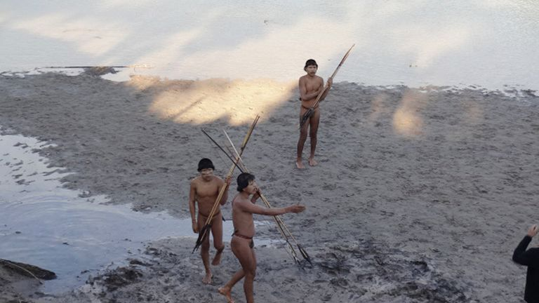 Tribesmen on the bank of the Envira river in Aldeia Simpatia, Brazil