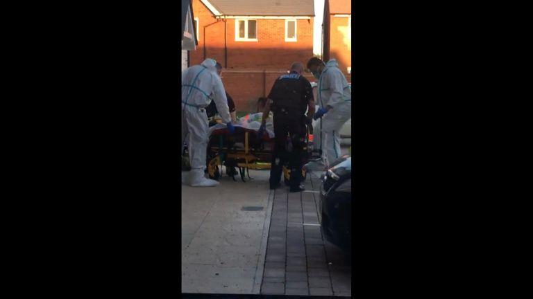 Paramedics wearing hazmat suits