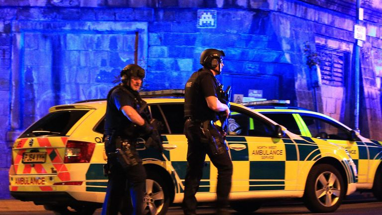 Armed police at Manchester Arena after an explosion at the venue during an Ariana Grande gig