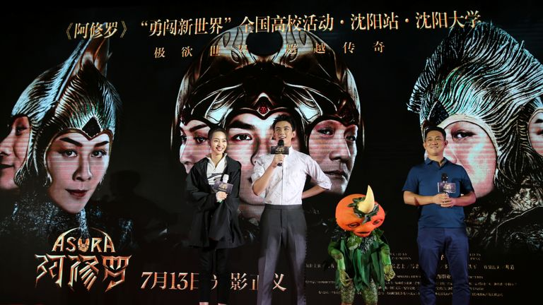 Director Zhang Peng (R) and actors Wu Lei (2nd L) and Zhang Yishang attend a promotional event for the movie Asura in Shenyang,