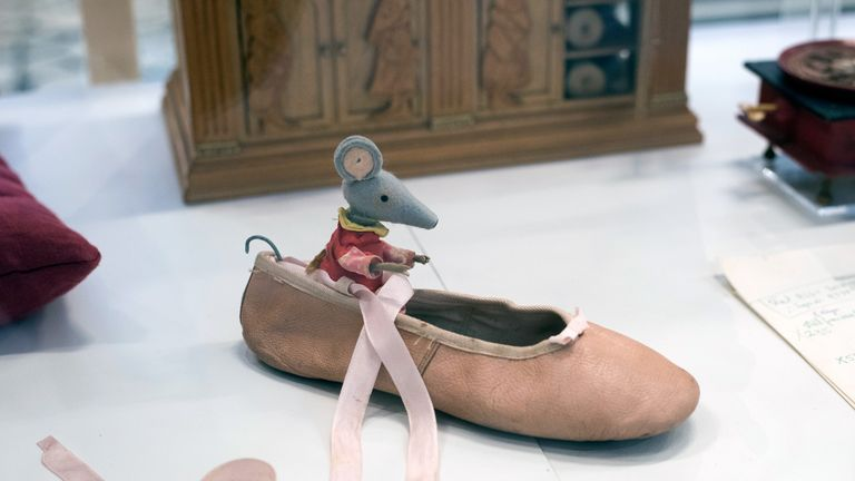 One of the Bagpuss organ mice takes a row in a ballet slipper