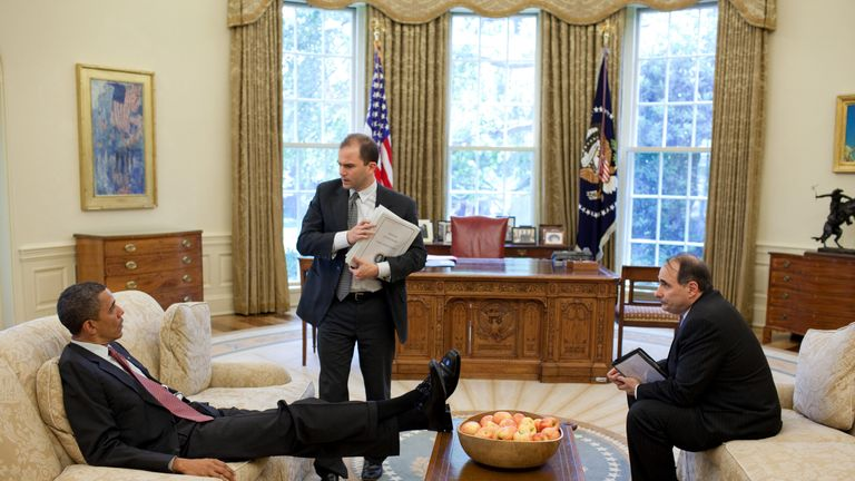 U.S. President Barack Obama talks with Deputy National Security Advisor for Strategic Communication Ben Rhodes