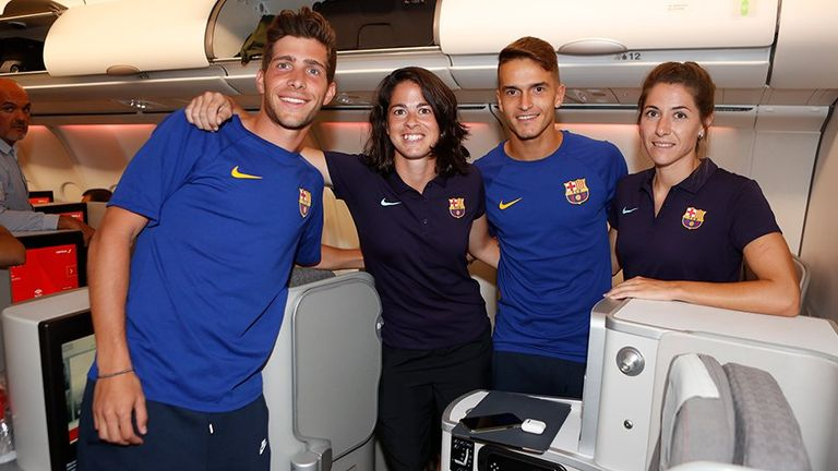 Male and female Barcelona players pose together on the plane before flying out to the US