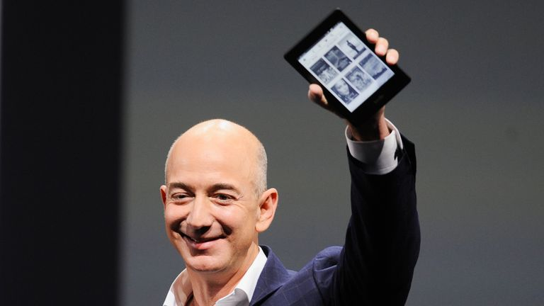 Amazon boss jeff Bezon with an Amazon Kindle