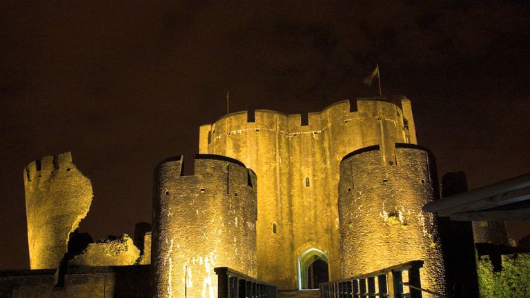 Caerphilly Castle in South Wales is lit in yellow, celebrating Geraint Thomas's Tour de France win