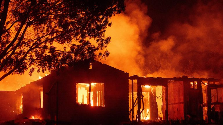 A house burns during the Carr fire in Redding, California