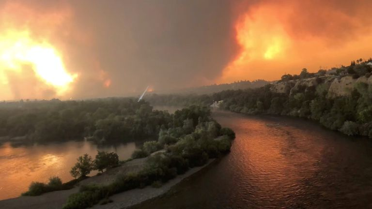 A wildfire spreads through Redding, California