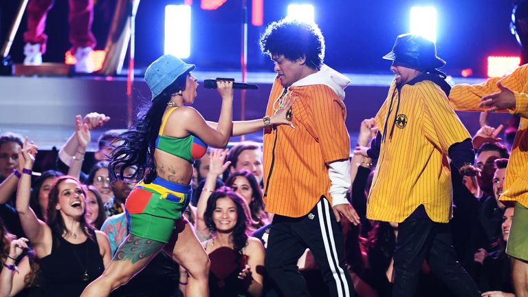 Rapper Cardi B and Bruno Mars perform together at this year's Grammy Awards