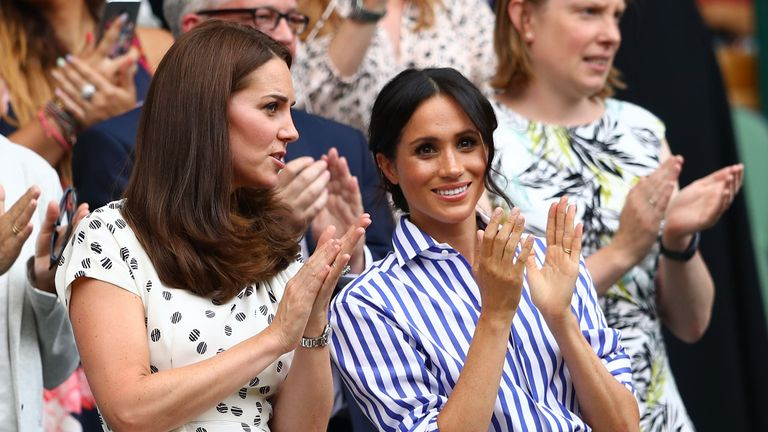 Catherine, Duchess of Cambridge and Meghan, Duchess of Sussex applaud ahead of the Ladies' Singles final match between Serena Williams of The United States and Angelique Kerber of Germany on day twelve of the Wimbledon Lawn Tennis Championships at All England Lawn Tennis and Croquet Club on July 14, 2018 in London, England