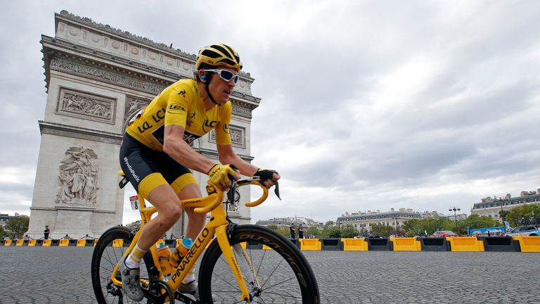 The 116-km Stage 21 from Houilles to Paris Champs-Elysees - July 29, 2018 - Team Sky rider Geraint Thomas of Britain, wearing the overall leader's yellow jersey, passes the Arc de Triomphe in the peloton