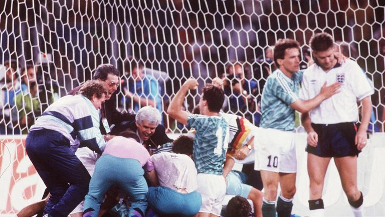 Chris Waddle is consoled by Germany's Lothar Mattheus after missing the decisive penalty at Italia 90