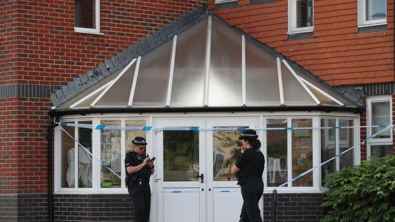 Police officers stand outside Amesbury Baptist Centre in Wiltshire
