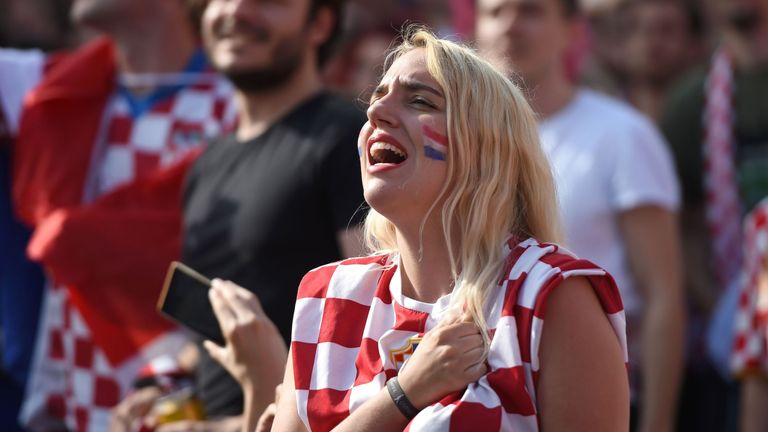 Croatian supporters stand to sing their national anthem in downtown Zagreb on July 15, 2018, during the 2018 Russia World Cup final football match between Croatia and France, the first final World Cup match ever in the history of Croatia. (Photo by ATTILA KISBENEDEK / AFP) (Photo credit should read ATTILA KISBENEDEK/AFP/Getty Images)