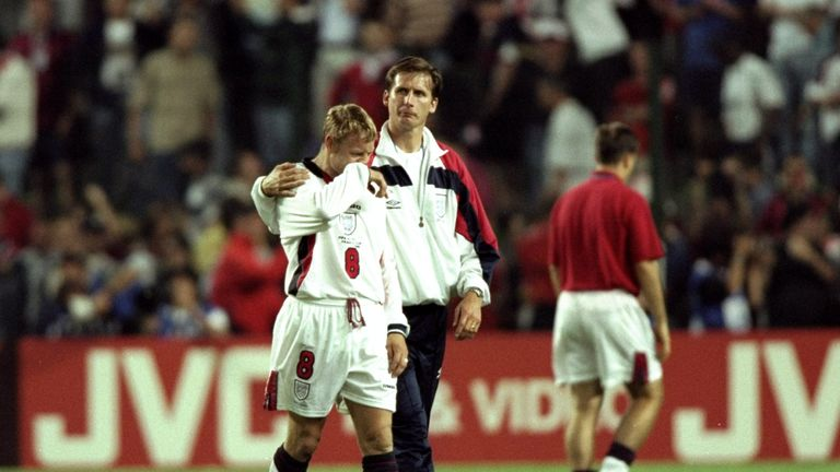 David Batty is consoled by coach Glenn Roeder after missing the decisive penalty against Argentina in 1998