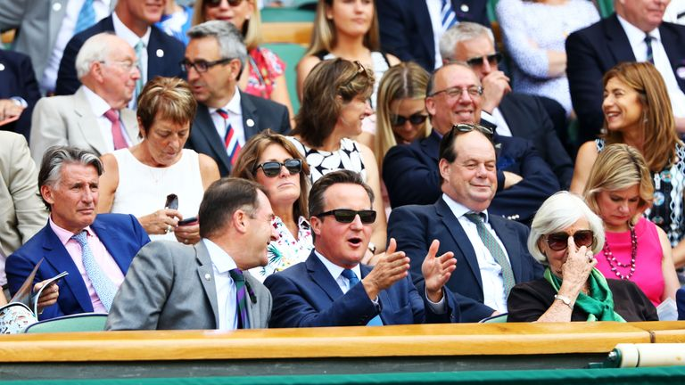 Mr Cameron regularly takes his mother (right) to the championships at the All England Club