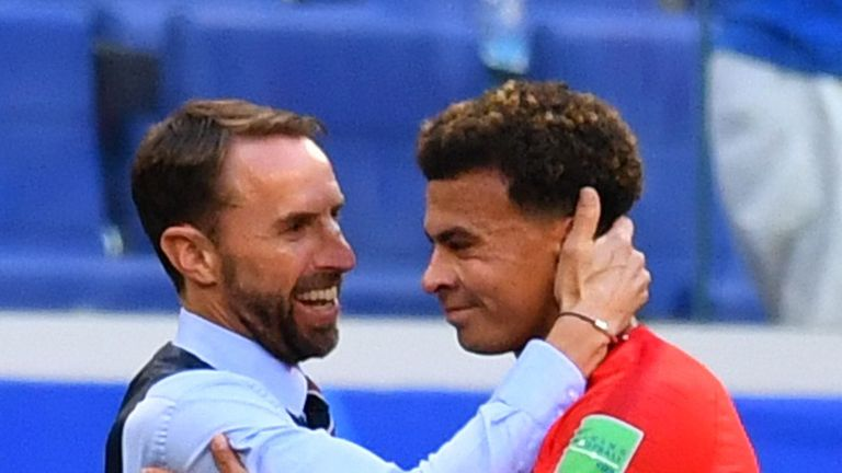 England's Dele Alli is substituted off while England manager Gareth Southgate looks on