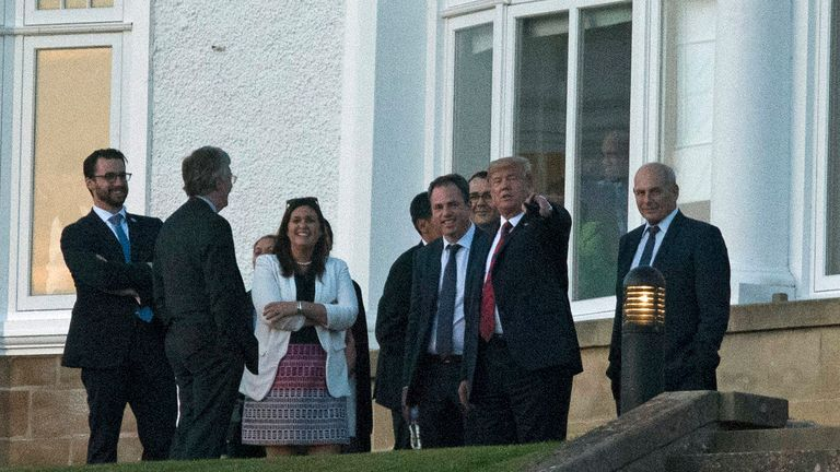 Donald Trump with members of his staff at the Trump Turnberry resort. Pic: John Linton/PA Wire