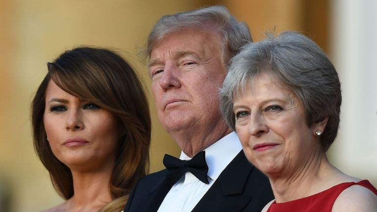 Melania Trump, US President Donald Trump and Theresa May stand at Blenheim Palace on first day of UK visit