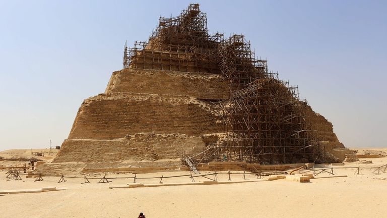 A tourists take a picture of the step pyramid of Djoser during a visit to the ancient Egyptian Saqqara necropolis some 20 kilometres south of Cairo on September 16, 2014. Egypt tried to end controversy about the restoration of the step pyramid of Djose, after facing accusations of endangering the famous pharaonic monument, dating back over 4,600 years, due to ongoing restoration work. AFP PHOTO/ MOHAMED EL-SHAHED (Photo credit should read MOHAMED EL-SHAHED/AFP/Getty Images)
