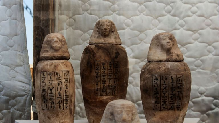 A picture taken on July 14, 2018 shows statuettes on display in front of the step pyramid of Saqqara, south of the Egyptian capital Cairo. - The Egyptian Minister of Antiquities announced the excavation of a mummification workshop discovered along with a communal burial place, consisting of several burial chambers. The work is being carried out south of the King Unas Pyramid in Saqqara by an Egyptian-German mission. (Photo by Khaled DESOUKI / AFP) (Photo credit should read KHALED DESOUKI/AFP/Get