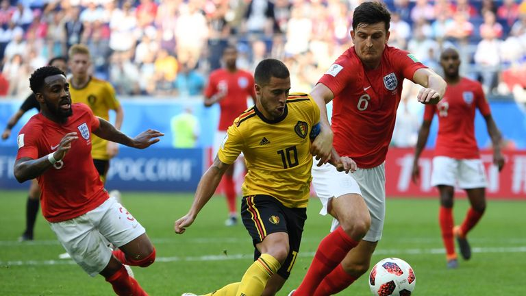 Belgium's forward Eden Hazard (C) runs with the ball past England's defender Danny Rose (L) and England's defender Harry Maguire during their Russia 2018 World Cup play-off for third place football match between Belgium and England at the Saint Petersburg Stadium in Saint Petersburg on July 14, 2018. (Photo by Paul ELLIS / AFP) / RESTRICTED TO EDITORIAL USE - NO MOBILE PUSH ALERTS/DOWNLOADS (Photo credit should read PAUL ELLIS/AFP/Getty Images)