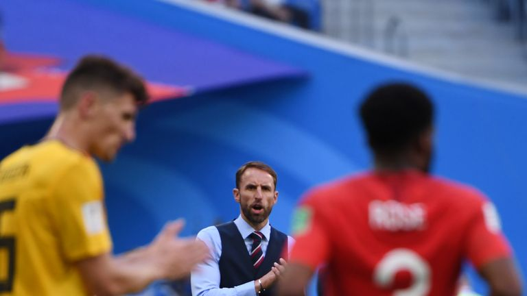 England's coach Gareth Southgate (C) cheers on his team during their Russia 2018 World Cup play-off for third place football match between Belgium and England at the Saint Petersburg Stadium in Saint Petersburg on July 14, 2018. (Photo by Paul ELLIS / AFP) / RESTRICTED TO EDITORIAL USE - NO MOBILE PUSH ALERTS/DOWNLOADS (Photo credit should read PAUL ELLIS/AFP/Getty Images)