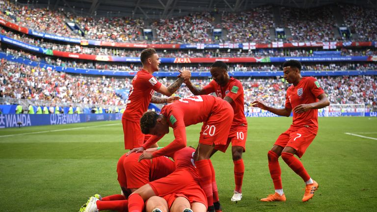 England celebrating their first goal