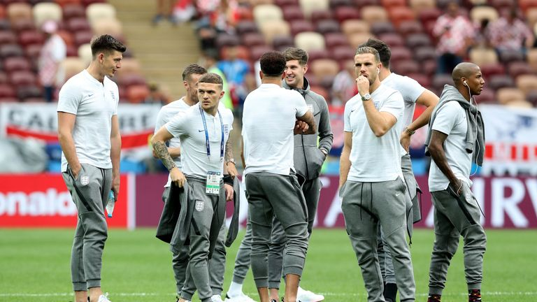 60799f94e World Cup 2018. England players take part in a pitch inspection ahead of  the match in Moscow