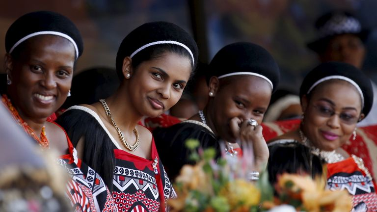 Four of King Mswati's 15 wives react during the last day of the Reed Dance at Ludzidzini Royal Palace in Swaziland, August 31, 2015. During the eight day ceremony, virgin girls cut reeds and present them to the queen mother. The Reed Dance also allows Swaziland's King Mswati III to choose a wife if he wishes. Mswati currently has 15 wives. REUTERS/Siphiwe Sibeko