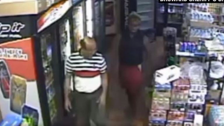 Mr Ali pictured on security camera with his suspected killer. Pic: Broward Sheriff's Office
