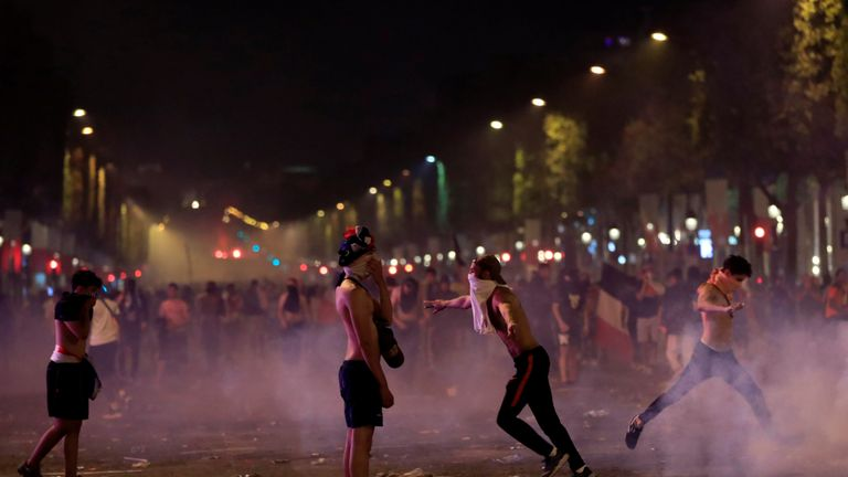 France fans are seen during clashes on the Champs-Elysees avenue after France win the World Cup final.
