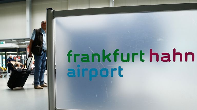 A passenger walks through the terminal of Frankfurt Hahn airport 100 kilometers (60 miles) west of Frankfurt, Germany June 6, 2016. REUTERS/Ralph Orlowski