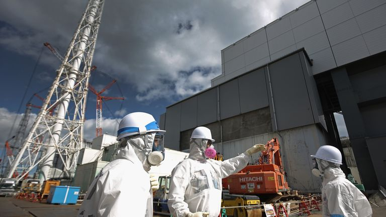 OKUMA, JAPAN - FEBRUARY 25: Workers stand outside reactor 4 as they continue the radiation decontamination process at the Tokyo Electric Power Co.'s embattled Fukushima Daiichi nuclear power plant on February 25, 2016 in Okuma, Japan. March 11, 2016 marks the fifth anniversary of the magnitude 9.0 earthquake and tsunami which claimed the lives of 15,894, and the subsequent damage to the reactors at TEPCO's Fukushima Daiichi Nuclear Power Plant causing the nuclear disaster which still forces 99,7