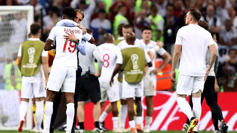 Gareth Southgate consoles the England players after the game