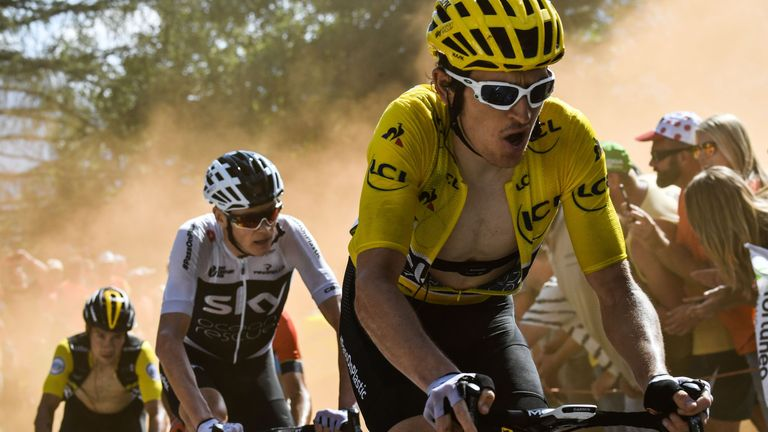 Geraint Thoms wears the overall leader's yellow jersey and Chri Froome is in the black and white Sky jersey