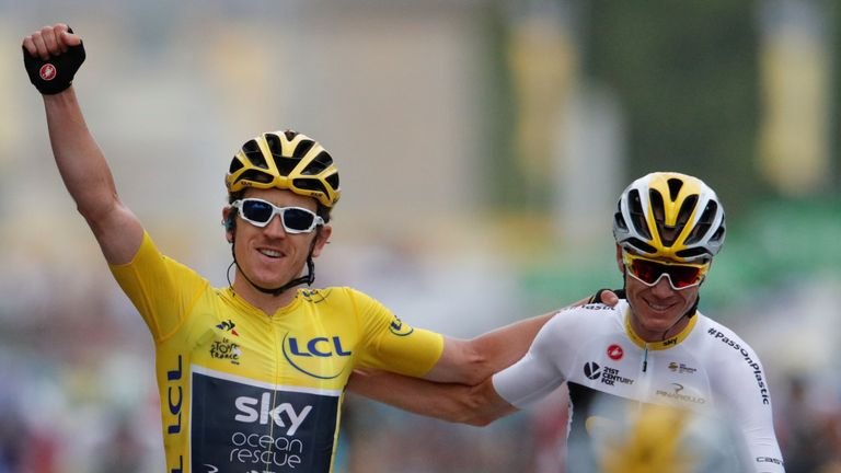 Team Sky rider Geraint Thomas of Britain, wearing the overall leader's yellow jersey, celebrates as he finishes with teammate Chris Froome