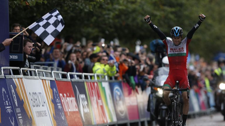 Wales' Geraint Thomas wins the Men's cycling road race during the 2014 Commonwealth Games in Glasgow, Scotland on August 3, 2014. AFP PHOTO / ADRIAN DENNIS (Photo credit should read ADRIAN DENNIS/AFP/Getty Images)
